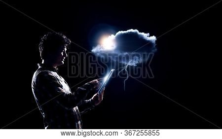 Man holding cloud with lightening