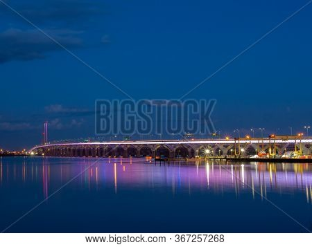 The Samuel De Champlain Bridge Linking Montreal With The South Shore Is Illuminated In Rainbow Color