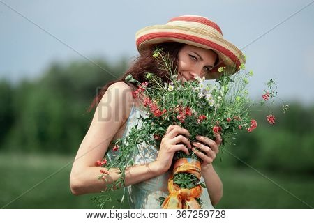woman with a bouquet of wildflowers