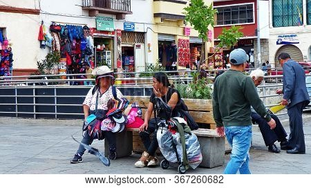 Cuenca, Ecuador - December 23, 2018: Plaza Civic Next To The Market In Cuenca. Two Unidentified Wome