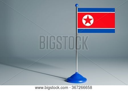 The 3d Rendering  Realistic National Flag Of North Korea On Steel Pole On Gray Isolated Background.