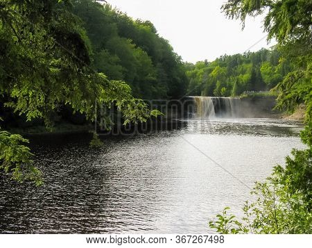 Framed By The Surrounding Trees, One Of The Most Voluminous Waterfalls In The Eastern U.s. Can Be Se