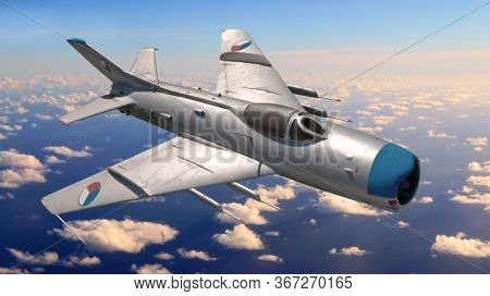 Domazlice / Czech Republic - May 17, 2020: Czechoslovak Mig 19 jet fighter flying over clouds on Czech border.