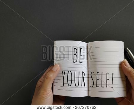 Motivational And Inspirational Quote Of Be Yourself Written On Notebook