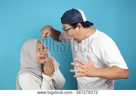 Portrait Of Funny Asian Muslim Couple Having Conflict, Wife And Husband Fight, Violence In Family, W