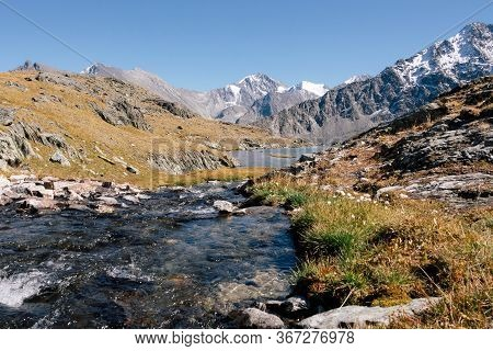 Rapid River In Autumn Mountains In The Valley Of River Akem On Backgroind Of Mountain Belukha. Altai