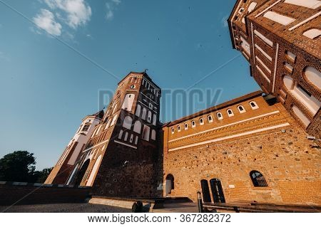 Mir Castle With Spires Near The Lake Bottom View In Belarus Near The City Of Mir