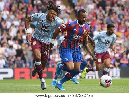 London, England - August 31, 2019: Tyrone Mings Of Villa (l) And Jordan Ayew Of Palace (r) Pictured