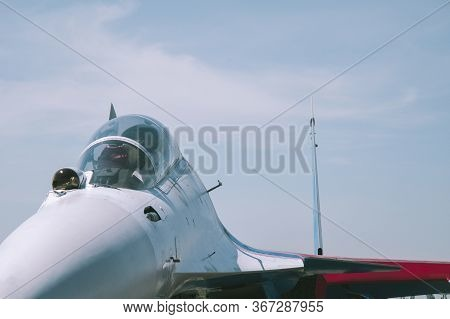 Modern Fighter Closeup. White Fighter Close-up Front View Against The Blue Sky. Military Aircraft Wi
