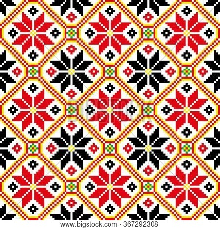 Embroidered Good Like Handmade Cross-stitch Ethnic Ukraine Pattern. Red And Black Flowers In Decorat