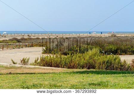 Beautiful Wild Beach Behind The Grass In Roquetas De Mar. August 14, 2019. Roquetas De Mar Almeria.