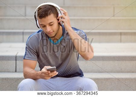 Listening To Music Young Latin Man Listen Headphones Copyspace Copy Space