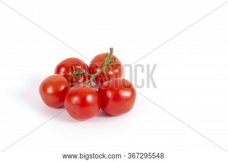 Fresh Tomatoes On Branch Isolated On White. Branch Of Delicious Five Tomatoes On The Left. Stock Pho