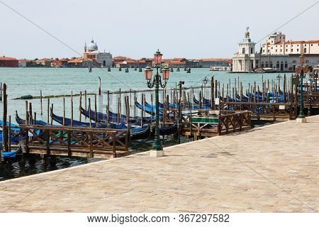 Many Gondolas Moored Without Tourists In Venice In Italy Near Saint Mark Square Due To The Corona Vi