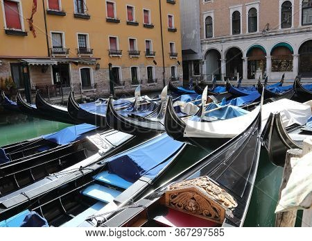Many Gondolas Moored Without Tourists In Venice In Italy Due To The Corona Virus Epidemic That Has B