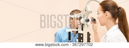 Ophthalmologist Doctor In Exam Optician Laboratory With Male Patient. Men Eye Care Medical Diagnosti