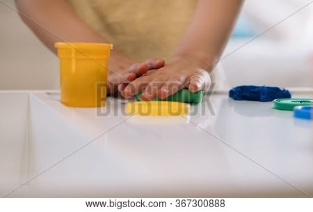 Cropped View Of Little Boy Sculpting With Colorful Plasticine