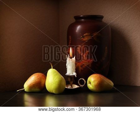 Still Life With Three Sweet Ripe Pears, Candlestick With Burning Candle And Beautiful Vintage Vase A