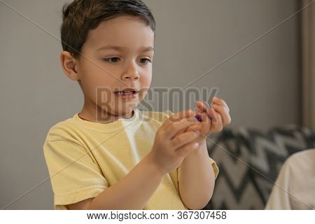 Adorable Boy Sculpting Figure With Plasticine, On Grey Background