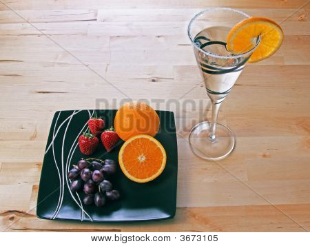 Cocktail With Orange Slice Strawberries And Grapes