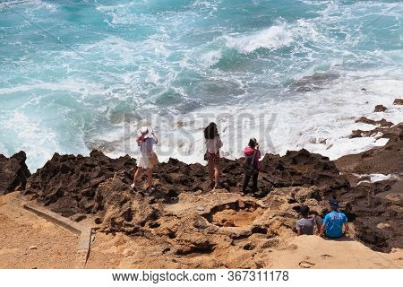 Tangier, Morocco - May 27, 2017: Unknown Young Women Take A Photos Of The Atlantic Ocean In Sunny Da