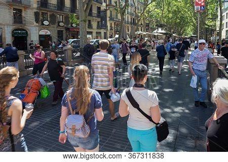 Barcelona, Spain - May 15, 2017: Unknown People Walking On The Famous La Rambla Street In Center Of