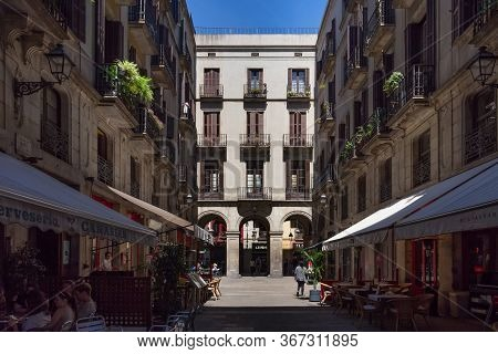 Barcelona, Spain - May 15, 2017: One Of The Old Streets In Famous Gothic Quarter Of Barcelona In Sun