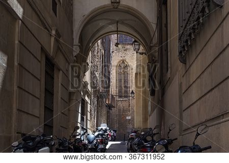 Barcelona, Spain - May 15, 2017: View From The Back Narrow Street To The Gothic Basilica Of Saints J