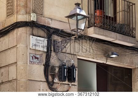 Barcelona, Spain - May 15, 2017: Old Streetlight In Facade Of The One Of The Historical Buildings In