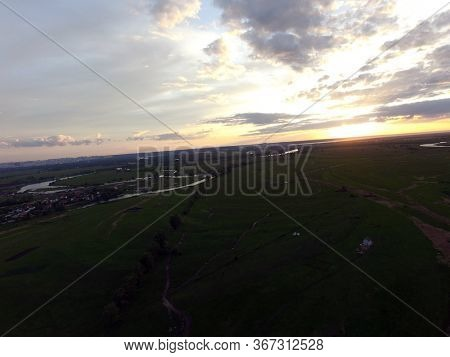 Aerial view of the saburb landscape (drone image). Near Kiev. Sunset time.May 20, 2020 Kiev Region,Ukraine