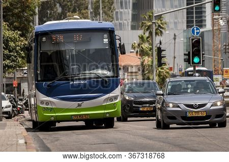 Tel Aviv, Israel. May 19, 2020. Green Blue And Gray Merkavim Bus Ran By The Kavim Bus Company And Pr