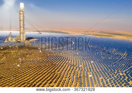 Aerial View Of A Solar Power Tower And Mirrors.