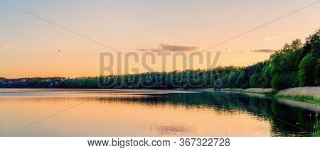 Panoramic View Of Lake Coast On Sunset In Spring. Lithuania, Kauno Marios.