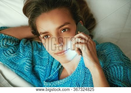 Young Beautiful Womanl In Bed Using Mobile Phone, Internet Addiction Concept