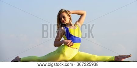 Attractive Woman Practicing Yoga. Splits Exercise. Workout For Gymnastic Split. Control Body. Fitnes