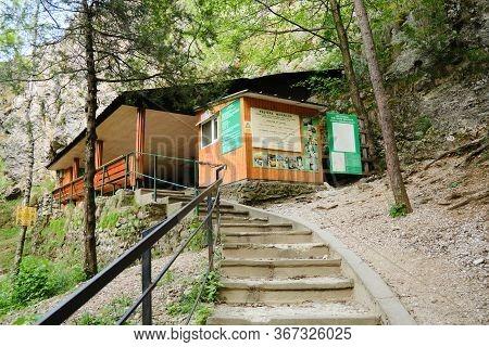 Stairs To Women Cave (pestera Muierilor) Main Entrance, A Popular Tourist Attraction In Baia De Fier