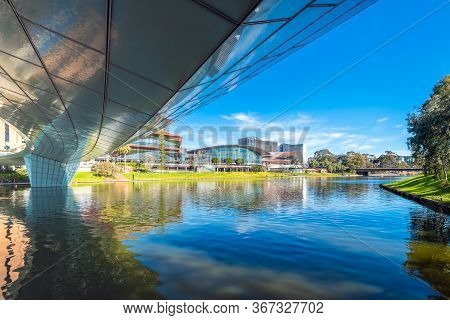 Adelaide City Riverbank Viewed From Under The Bridge On A Bright Summer Day