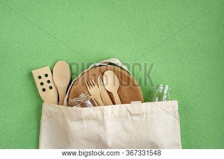 Zero Waste Cotton Bag. Zero Waste Concept. Textile Eco Bag, Glass Jars, Wooden Kitchen Accessories O