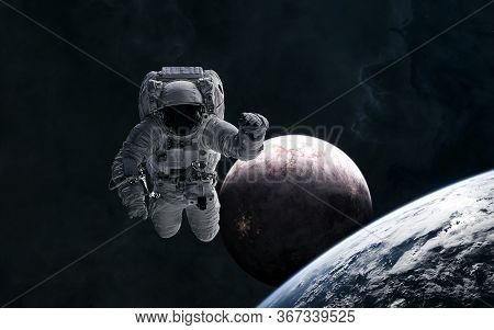 Astronaut In Outer Space. Inhabited Planets In Deep Space. Science Fiction. Elements Of This Image F