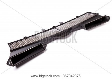 Plastic Grille For The Cabin Air Filter In Black On A White Isolated Background For Replacement When