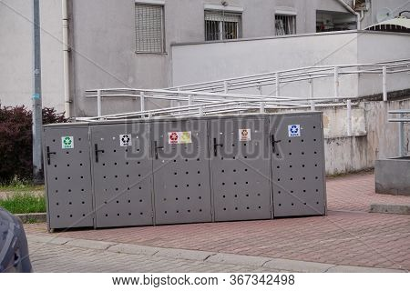 Metal Garbage Bins Of Different Colors For Separate Collection Of Garbage And Further Processing. Sc