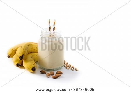 Banana Smoothie With Almond In Jar Isolated On White Background. Copy Space