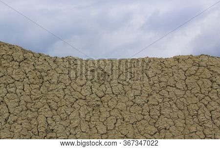 Dry Mud Dunes Near Mud Volcanoes In Romania. The Berca Mud Volcanoes Is A Geological And Botanical R
