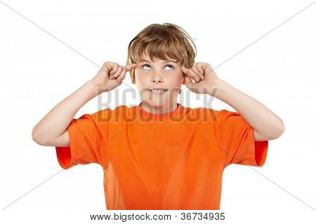 Portrait of smiling boy in orange t-shirt with rolled eyes and forefingers near his temples