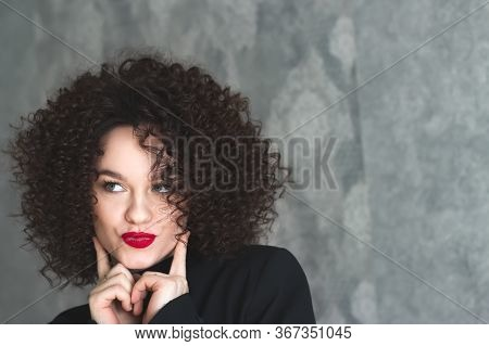 Close-up Portrait Of A Young Beautiful Girl Who Is Posing. Make-up With Red Lipstick On The Lips. Cu