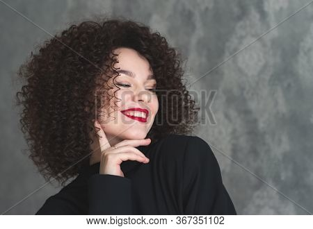 Close-up Portrait Of A Young Beautiful Girl Who Is Posing And Smile. Make-up With Red Lipstick On Th