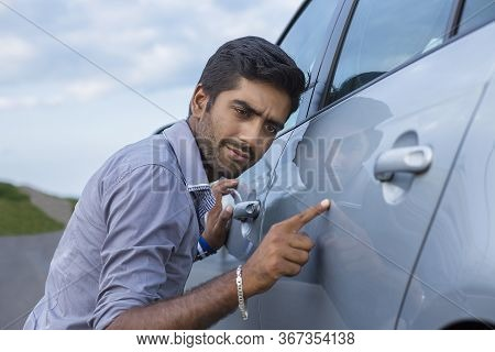Young Worried Funny Looking Man Obsessing About Cleanliness Of His New Car. Car Care And Protection