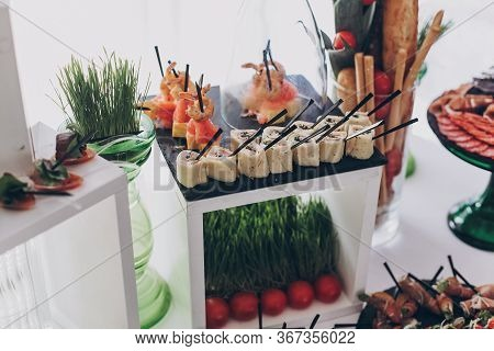 Delicious Delicatessen, Mediterranean Snacks, Cheese And Olives, Appetizers On Table At Wedding Rece