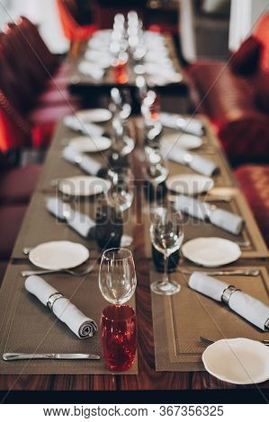 Luxury Red Table Setting At Reception In Restaurant For Wine Party Or Wedding. Stylish Glasses For W