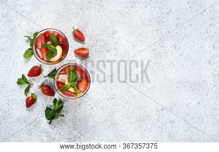 Lemonade With Strawberries And Mint On A Concrete Background. View From Above. Summer Cold Drink.